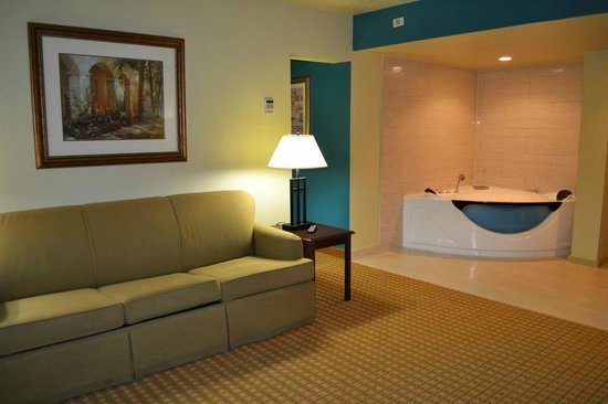 Lovely PG Waterfront Hotel U0026 Suites: Living Room To King Suite With Jacuzzi Tub