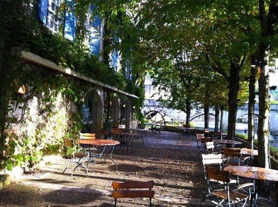 The Riverside terrace outside the restaurant at Le Moulin de l'Abbaye