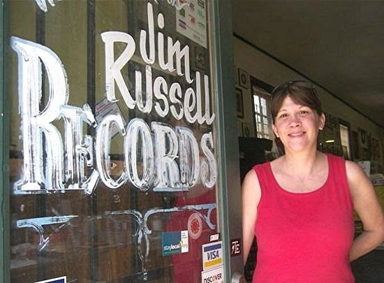 Jim Russell Records: Denise Russell at the door of her store