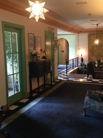 The Club Continental Suites: Second floor hallway, patio on left