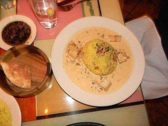 Dishdash: chicken, potatoes, almonds, raisins in bed of rice