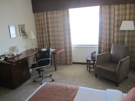 New Africa Hotel : Bedroom view- nice ergonomic chair to work