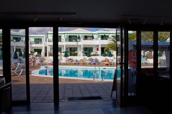 Club Las Calas: The swimming pool taken from inside the 361 Restaurant