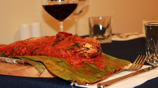 Radio Malabar : Fish wrapped in banana leaf and shallow braised.