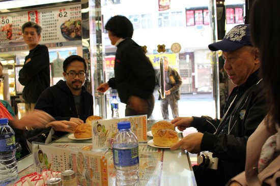 Hong Kong Foodie Tasting Tours: Everyone enjoying our first stop - Pineapple buns & coffee