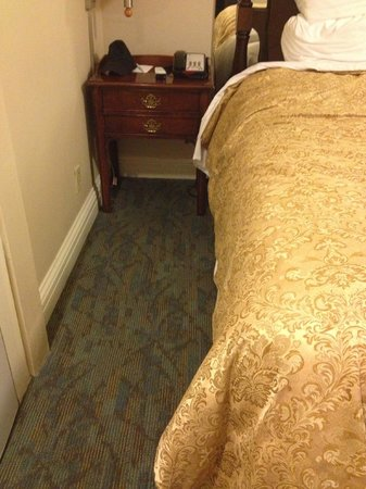 Inn at the Opera: Very narrow space to walk around the side of the bed