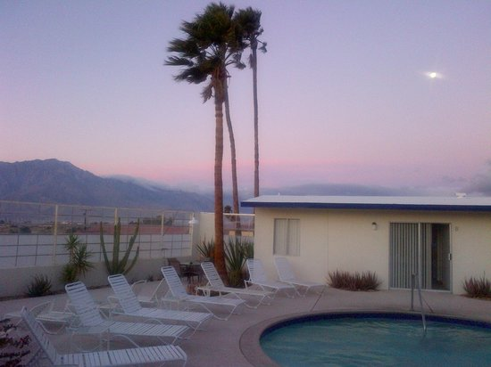 Living Waters Clothing-optional Spa: Early morning pool, palm tree, moon and mountains.