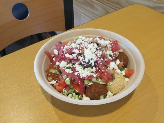 Olea Mezze Grill : Cous-Cous bowl with falafel, hummus, spicy harissa, eggplant & red pepper spread, and toppings!