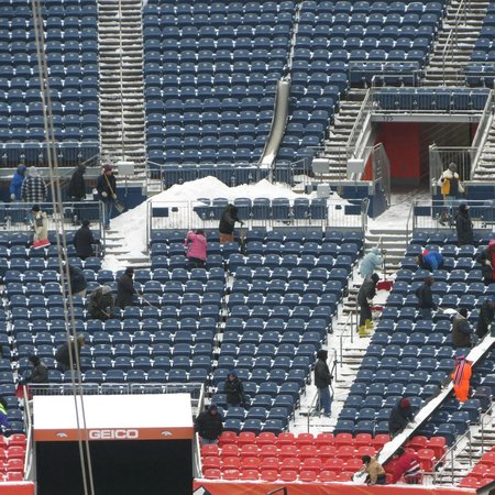 Sports Authority Field at Mile High: crew cleaning the snow