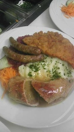 Taste of Berlin German Restaurant: Trio plate porkroll stuffed with sauerkraut, bratwurst and schnitzel