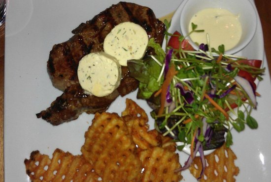 Rustlers Steakhouse and Grill: Rib eye with blue cheese butter