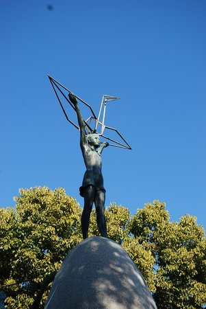 Children's Peace Monument: Bronze statue of young girl and a golden crane, 'entrusted with dreams of a peaceful future'.