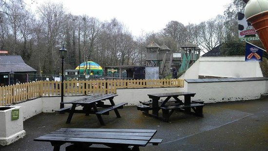Trago Mills Family Shopping & Leisure Park: seating area by children's attractions
