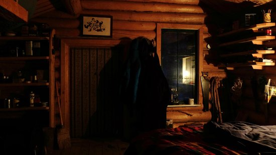 Sirius Sled Dogs & Aurora Tours: Cosy inside of our cabin for the night lit with Parafin Lamps