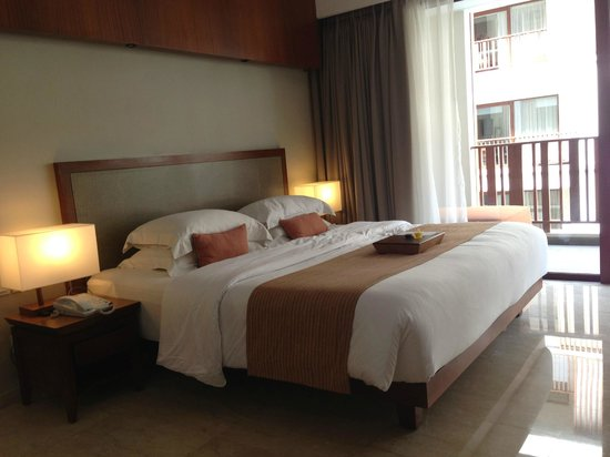 The Magani Hotel and Spa: Spacious room with a balcony overlooking the pool