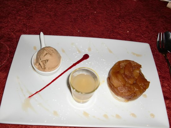 "La Villa Restaurant: Upside down pear tart ""Tatin"", homemade caramel ice cream, with a pear consommé"