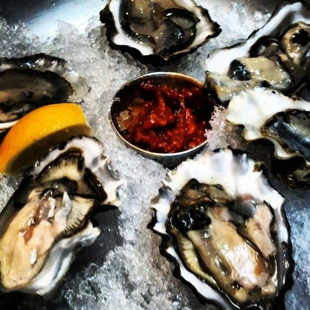Local Restaurant & Bar : Can't get much better than fresh Oysters in a half shell. Best oysters I've had that's not been