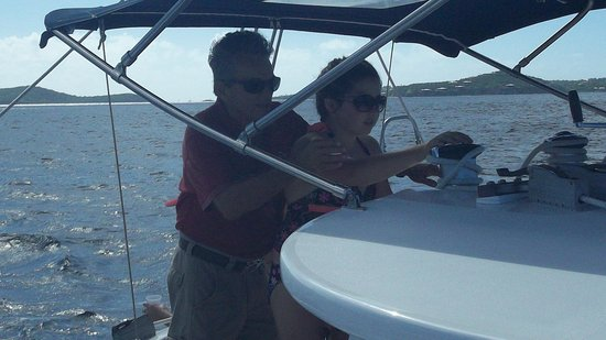 Cruz Bay Watersports: Captain Richard instructs my daughter on how to point the boat