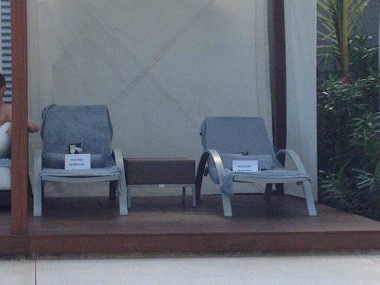 Secrets The Vine Cancun Resort & Spa: Boooooo - reserved chairs in the shady cabanas