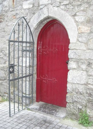 Eyre Square : Arched Red Door with Wrough Iron Gate