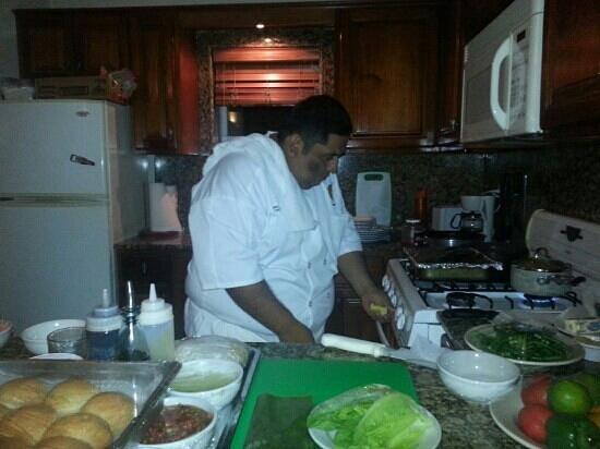 Belizean Dreams: Chef Louis cooking in house