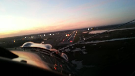 St. Augustine Biplane Rides: landing after sunset