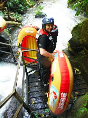 Bali Quad Canyon Tubing: A bit of walking and jumping on the boats.