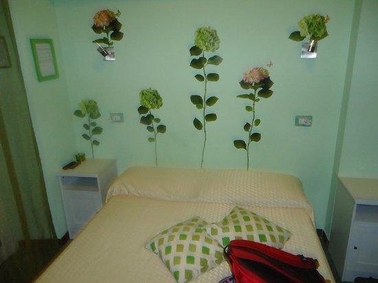 Bed & Breakfast Rhome86: decoración y cama