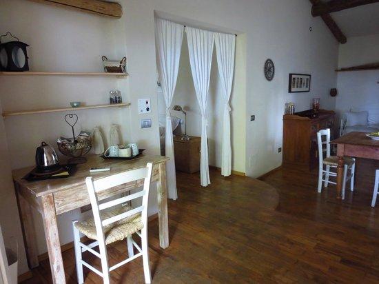 Relais Poggio Ai Santi: living room area of our garden suite room
