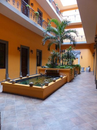 Hotel Morales Historical & Colonial Downtown Core: Fish Pond and sitting area outside our room
