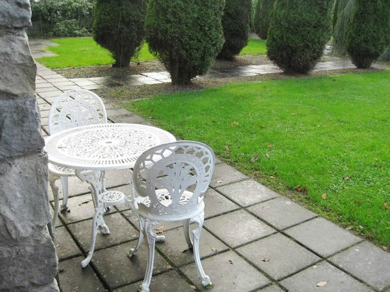 Cabra Castle Hotel : Wrought iron Patio Set for Room #55 in Courtyard Walled Garden