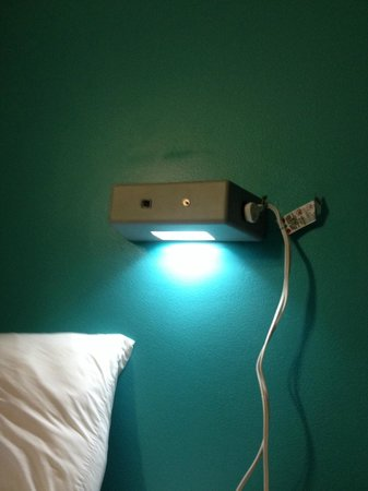 Hostelling International - New York: A light for each bed with an outlet on each side of fixture