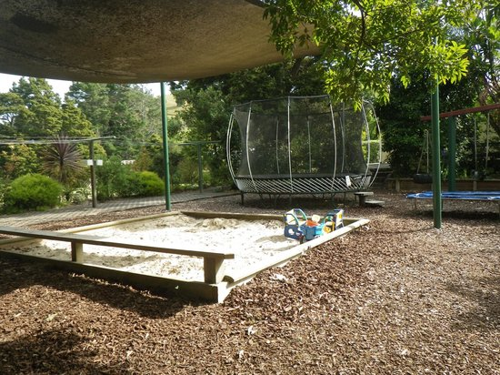 Kauri Coast Top 10 Holiday Park : two of the FIVE trampolines
