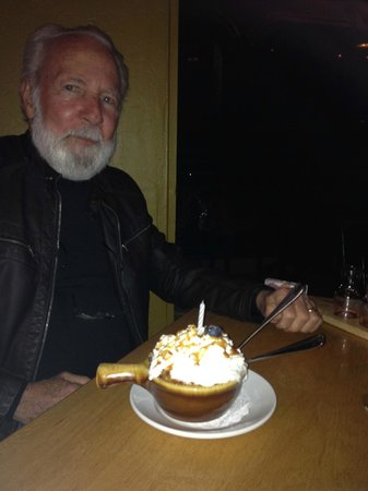 "Creekside American Bistro: My hubby with ""famous peach cobbler"""