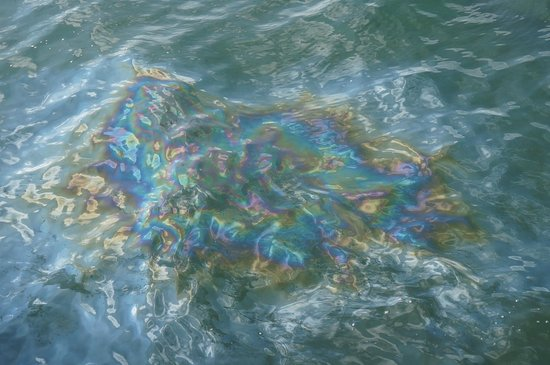 USS Arizona Memorial/WW II Valor in the Pacific National Monument : Oil slick on water over the Arizona