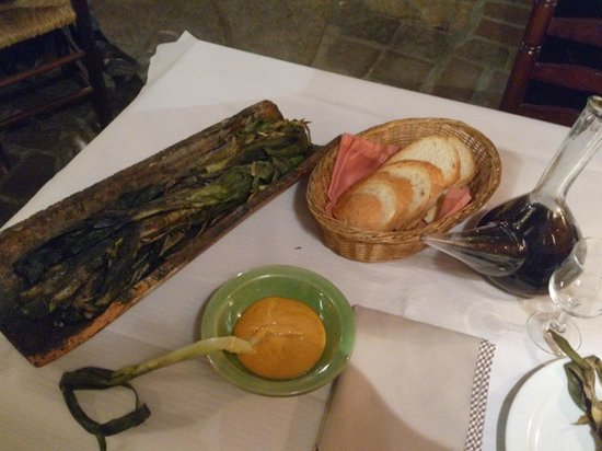 Cal Ganxo: Calçot served on tile (a kind of onion)