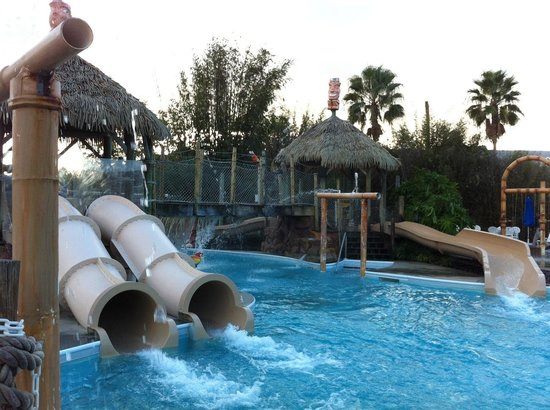 Liki Tiki Village: A glimpse of the pool area with a few of the slides.