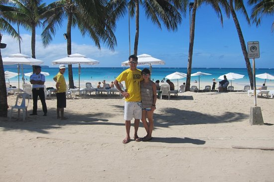 Henann Regency Resort & Spa: us in front of the hotel beachfront on a sunny day.