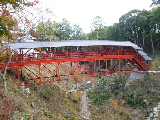 "Hokoji Temple: Picturesque red ""turtle's back"" bridge"