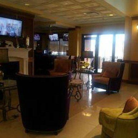 Mardi Gras Casino & Resort: Lobby near bar / Plenty of TV's