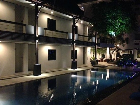 Surintra: swimming pool. My room was on the ground floor, in between two columns on the picture