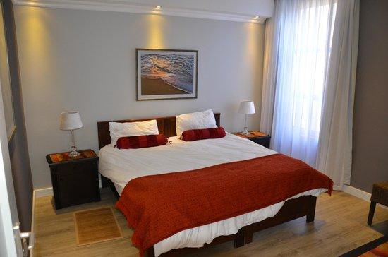 Sea Breeze Guesthouse: Schlafzimmer in der Erdgeschosswohnung