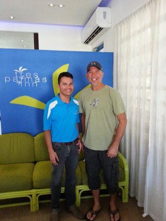Tres Palmas Inn: In the lobby, with owner Edwin on the right, Jose on the left