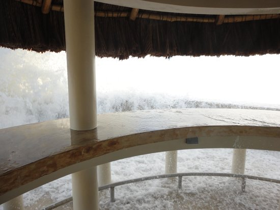 The SPA Retreat Boutique Hotel: waves crashing over tiky hut sunset bar