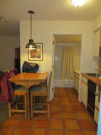 The Santa Fe Suites: kitchen / bathroom area