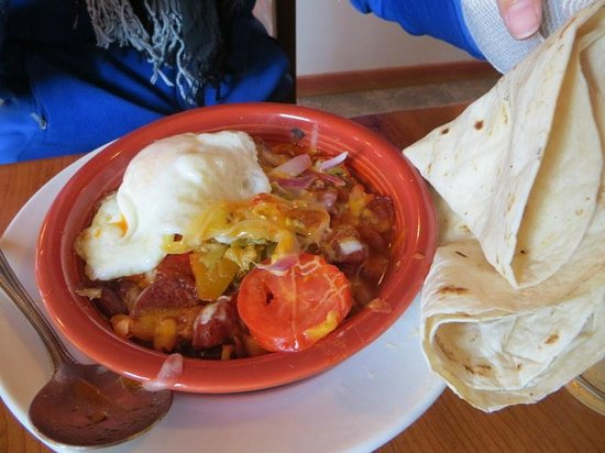 Gutiz: green chile sausage bowl topped with egg