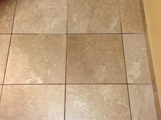 Foyer Tile Grout : Coffee spill settled in the tile grout of entry foyer