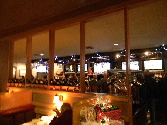 By-Th'-Bucket Bar and Grill: View of the bar over the booths