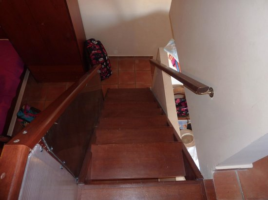 Asterias Village Resort: Stairs from main bedroom to downstairs accomodation