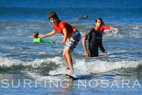 Nosara Tico Surf School : Dylan during his surf lesson with coach Oscar! Way to go buddy!